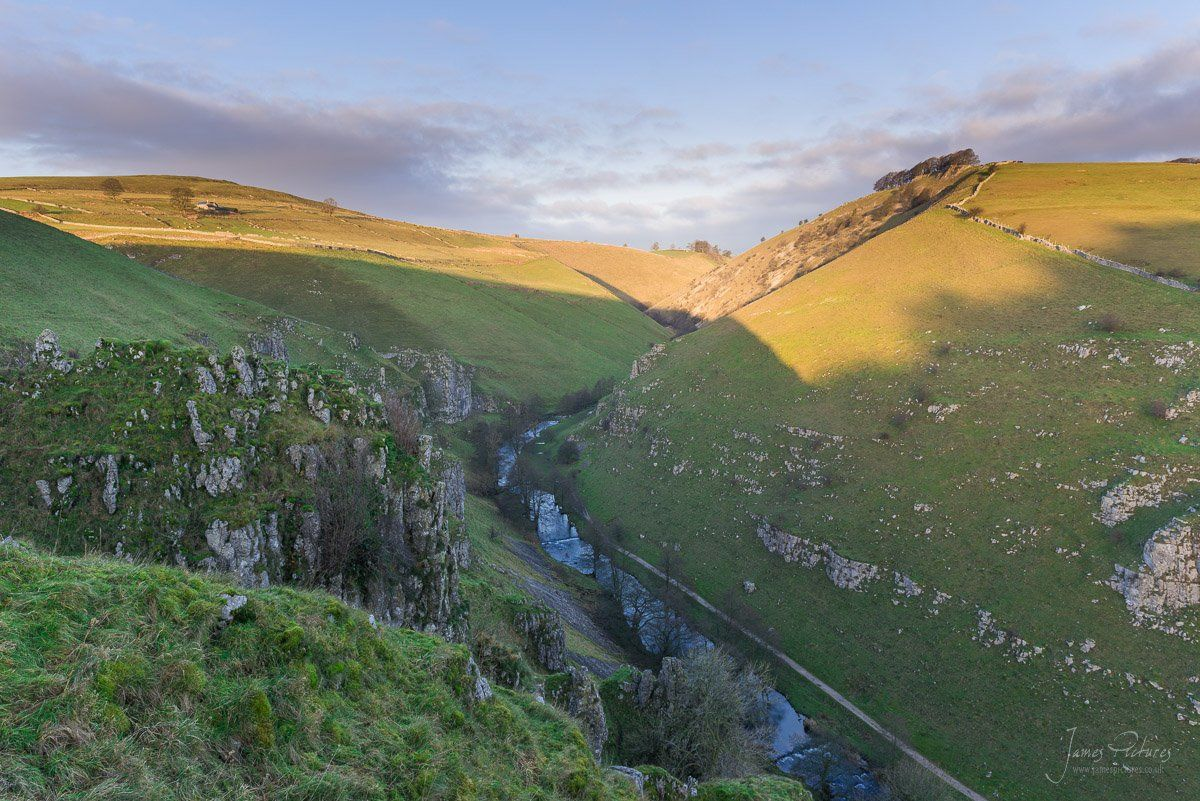 Sunrise from Drabber Tor looking North up Wolfscote Dale and the River Dove.