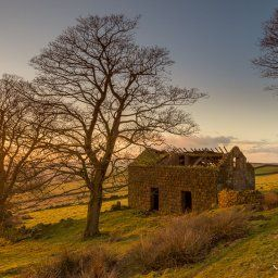 Roach End Barn at sunset, an old derelict out building which was probably part of Roachend Farm.