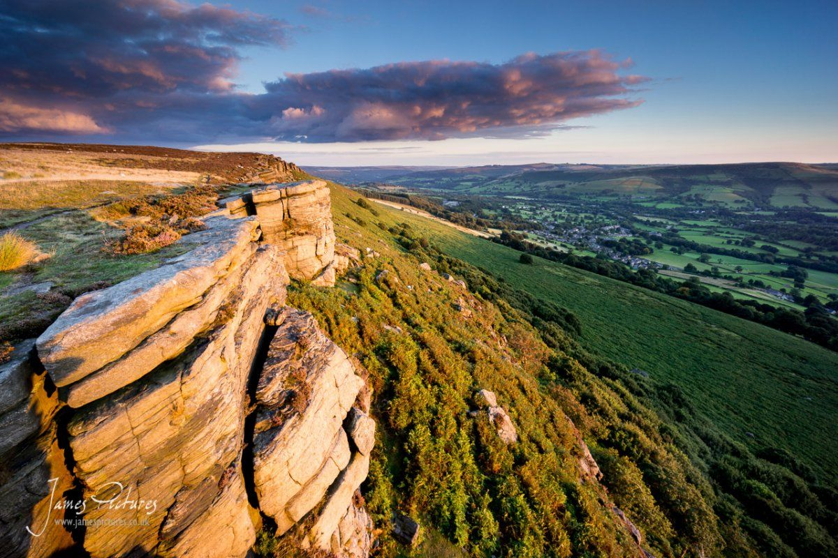 The gritstone on Bamford Edge is lighted up by the setting sun