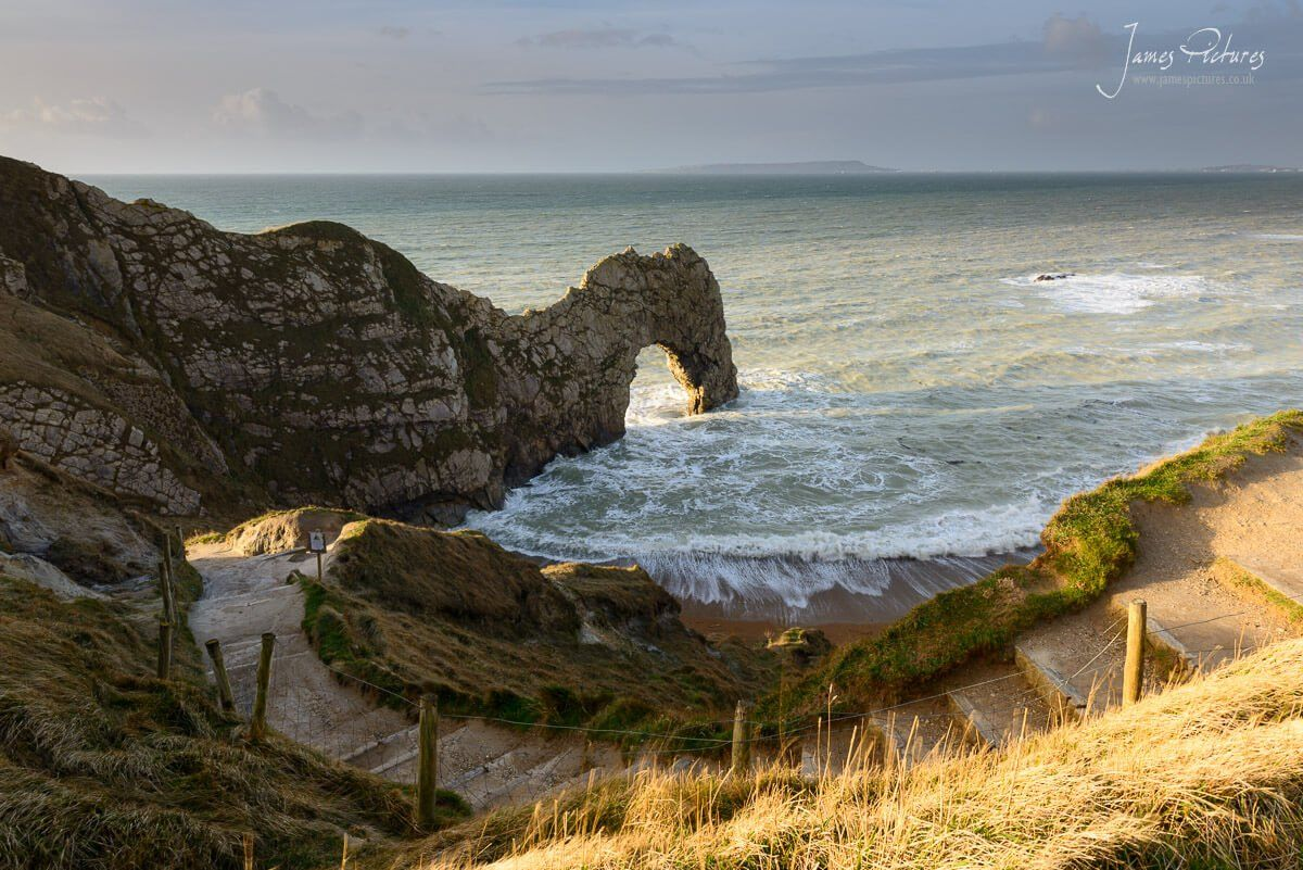 Durdle Door on the amazing Jurassic Coast as the sun rises behind me