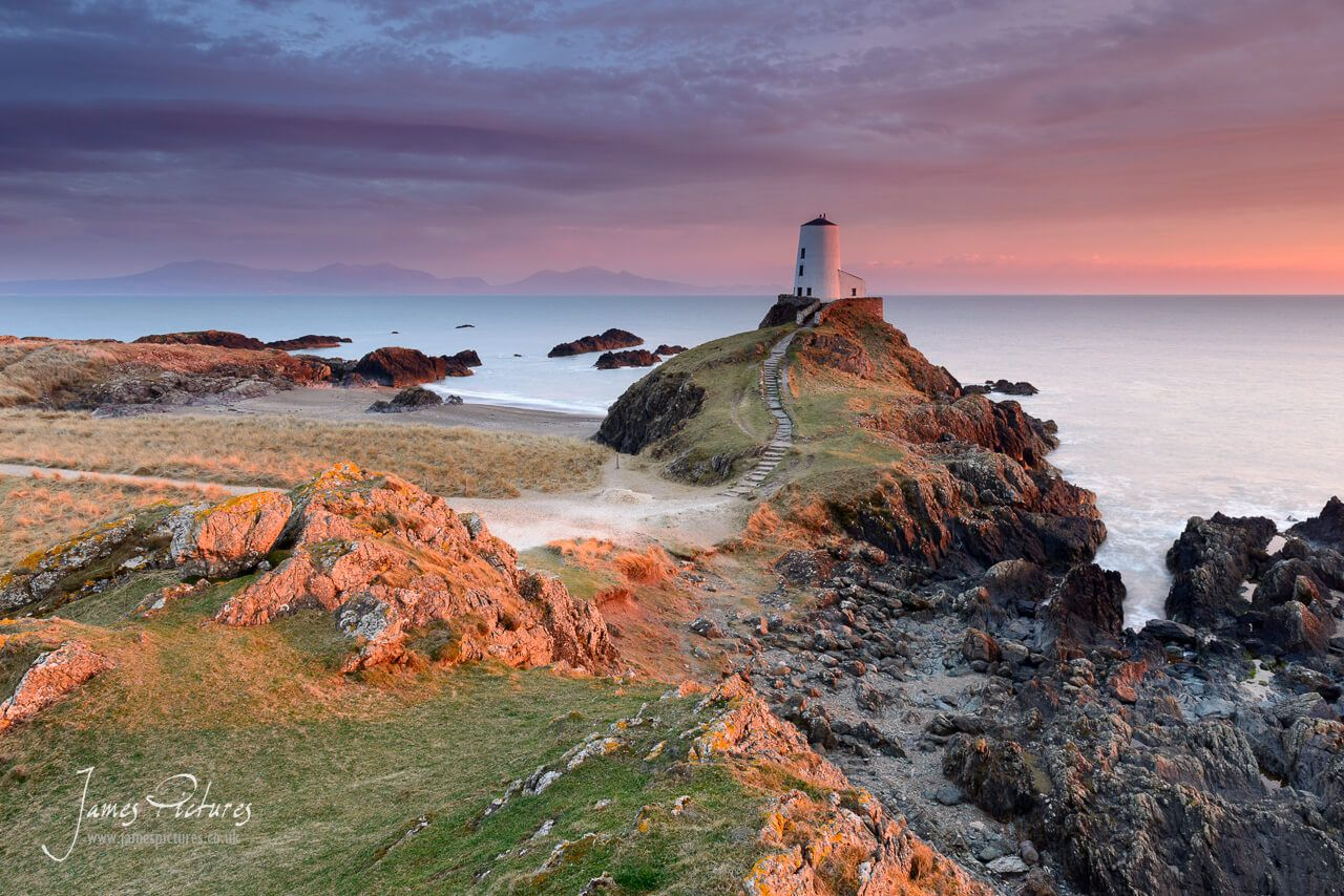 The stunning Llanddwyn Island Lighthouse at sunset. Llanddwyn Island is one of those places that you must visit if coming to wales, its views are speechless and breathtaking.
