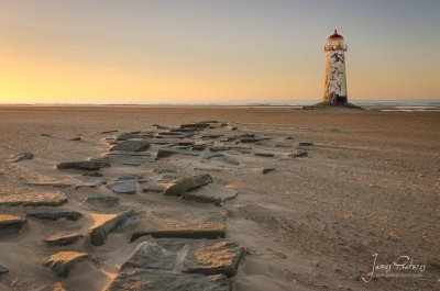 Point of Ayr Lighthouse, built in 1776, though inactive since 1844. It stands on Talacre beach, at the entrance to the River Dee estuary.
