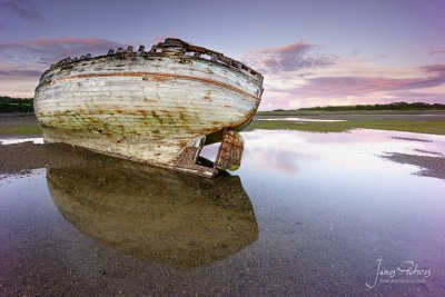 An old stranded vessel in Dulas Bay in Anglesey taken on a September evening as the sun set behind me.
