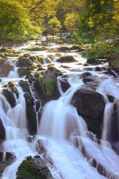 The roar of the cascading water at Swallow Falls Waterfall is a must for visitors to North Wales.
