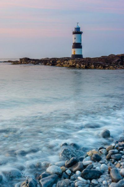 Trwyn Du Lighthouse near Penmon in Anglesey North Wales with the sunset light taken in July 2013