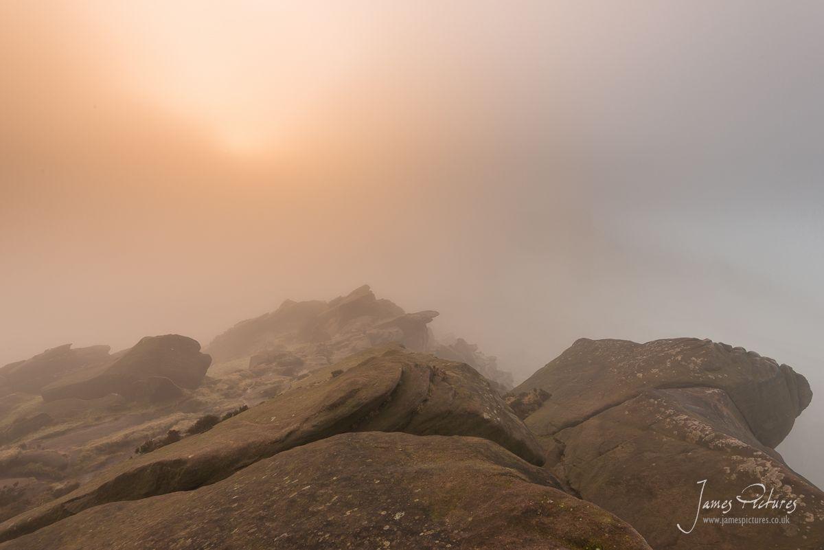 The Roaches sun breaking through the mist
